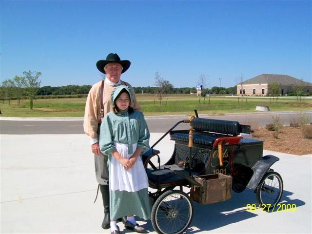 Elvis Howell and Granddaughter with 1901 Olds